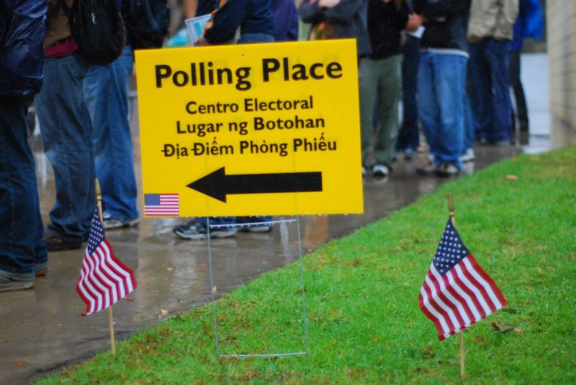 Vote! Voters waiting in rain at polling place